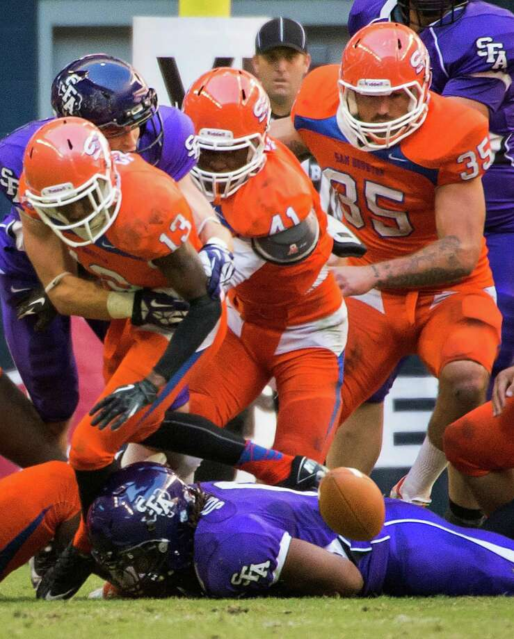 Sam Houston State cornerback DeAntrey Loche (13), safety Tyrel Stokes (41) and linebacker Tanner Brock (35) give chase to a fumble by Stephen F. Austin running back Gus Johnson. Photo: Smiley N. Pool, Houston Chronicle / © 2013  Houston Chronicle