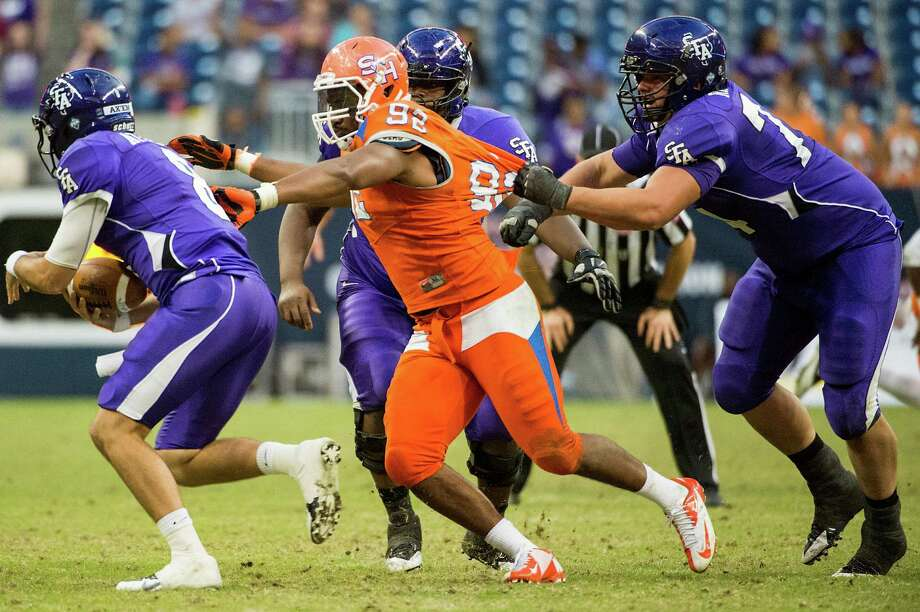 Sam Houston State defensive end Andrew Weaver (92) sacks Stephen F. Austin quarterback Brady Attaway. Photo: Smiley N. Pool, Houston Chronicle / © 2013  Houston Chronicle