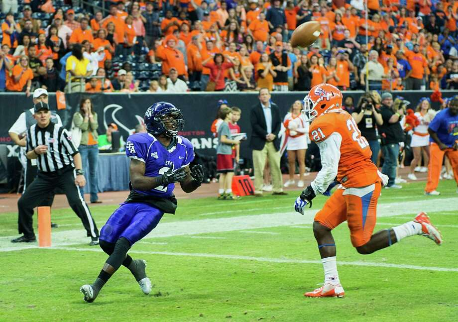 Stephen F. Austin wide receiver Mike Brooks (2) catches a touchdown pass as Sam Houston State defensive back Desmond Fite (21) defends late in the fourth quarter. Photo: Smiley N. Pool, Houston Chronicle / © 2013  Houston Chronicle