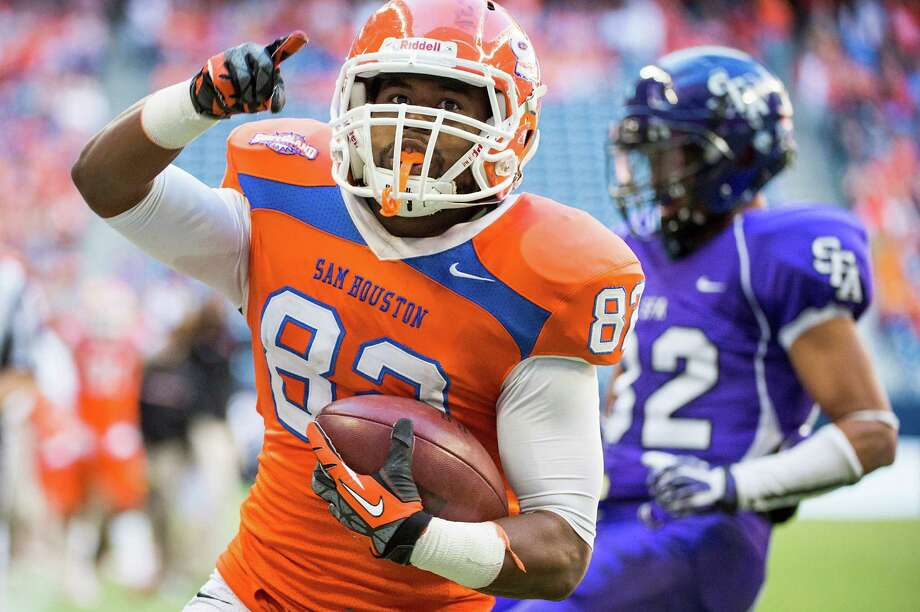 Sam Houston State wide receiver Stephen Williams celebrates after scoring on a touchdown reception. Photo: Smiley N. Pool, Houston Chronicle / © 2013  Houston Chronicle