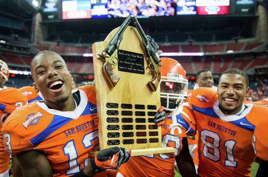 Sam Houston State cornerback DeAntrey Loche (13), running back Timothy Flanders (20) and wide receiver Chance Nelson (81) celebrate after the win. Photo: Smiley N. Pool, Houston Chronicle / © 2013  Houston Chronicle