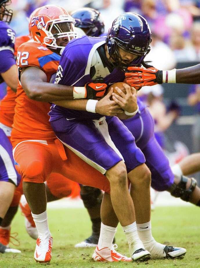 Stephen F. Austin quarterback Brady Attaway is sacked by Sam Houston State defensive end Andrew Weaver. Photo: Smiley N. Pool, Houston Chronicle / © 2013  Houston Chronicle