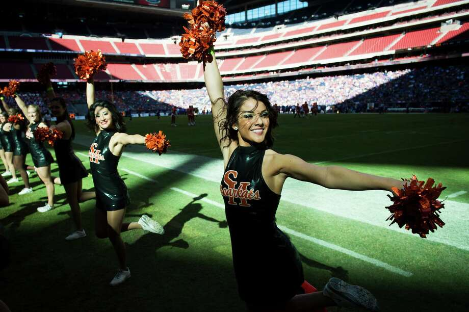 Sam Houston State cheerleaders perform during the 88th Battle of the Piney Woods. Photo: Smiley N. Pool, Houston Chronicle / © 2013  Houston Chronicle