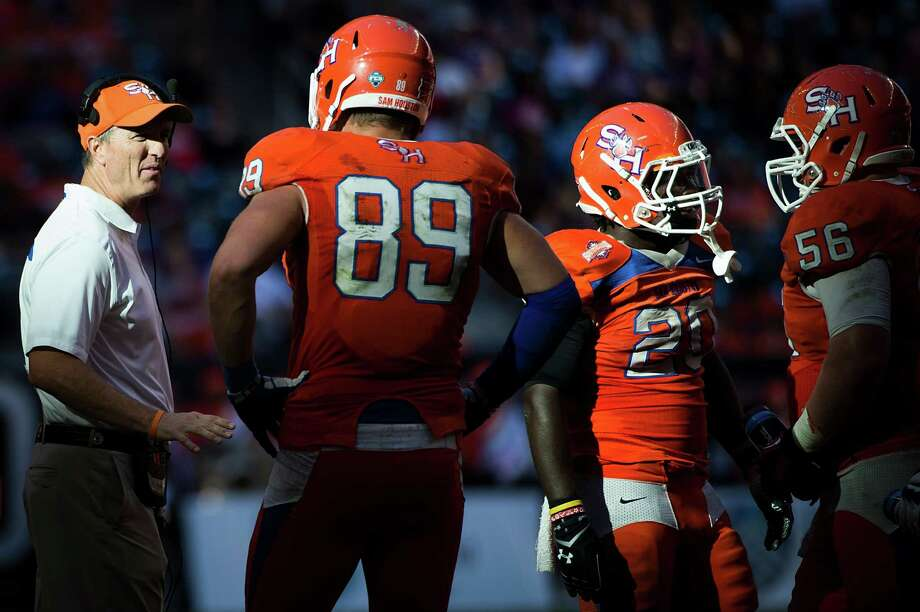 Sam Houston State head coach Willie Fritz talks to tight end Shane Young (89), running back Timothy Flanders (20) and offensive linesman Zachary Stevens (56) during a timeout. Photo: Smiley N. Pool, Houston Chronicle / © 2013  Houston Chronicle