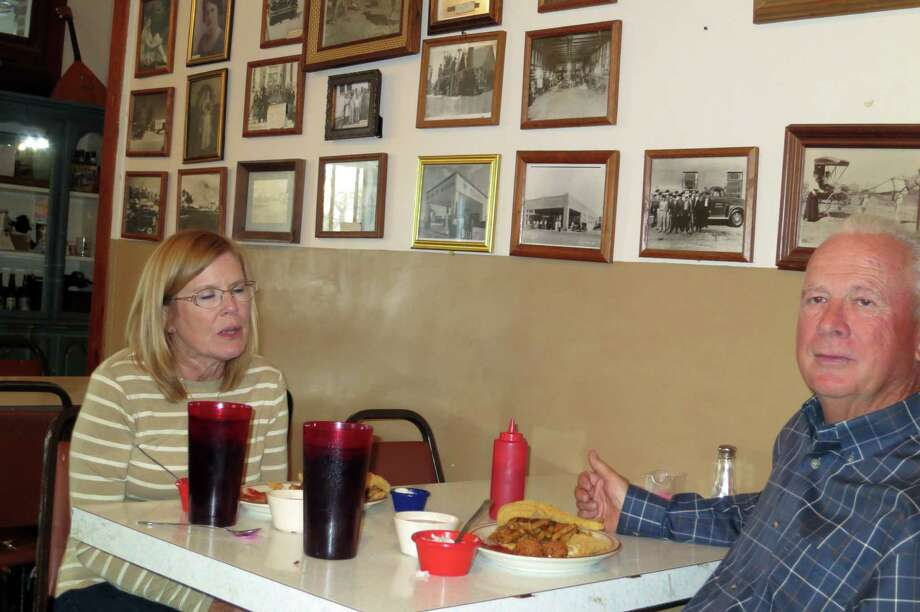The Englands, Valerie and Allen, were enjoying a catfish dinner at the Turkey Hotel, a couple of weeks after Allen's encounter with a rattlesnake, in Turkey, Texas. Photo: Joe Holley, Houston Chronicle / Houston Chronicle