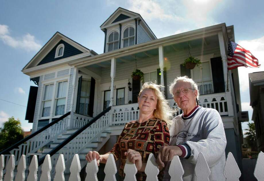 Bill and Lynette Haaga stand in front of their home on Winnie Ave. in Galveston. Changes to the National Flood Insurance Program will boost insurance rates that exceed what homeowners can afford. Photo: Cody Duty, Staff / © 2013 Houston Chronicle