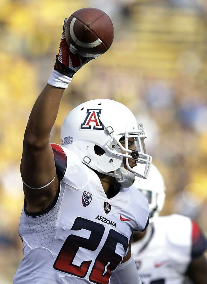 Arizona safety Jourdon Grandon celebrates his fourth-quarter interception. Photo: Jeff Chiu, Associated Press