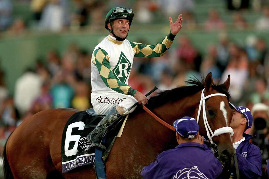 Gary Stevens celebrates aboard Mucho Macho Man after winning the Breeders' Cup Classic on Saturday. Photo: Matthew Stockman, Staff / 2013 Getty Images