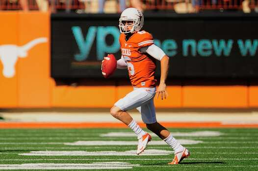 Case McCoy #6 of the Longhorns looks for an open receiver against the Jayhawks. Photo: Stacy Revere, Getty Images