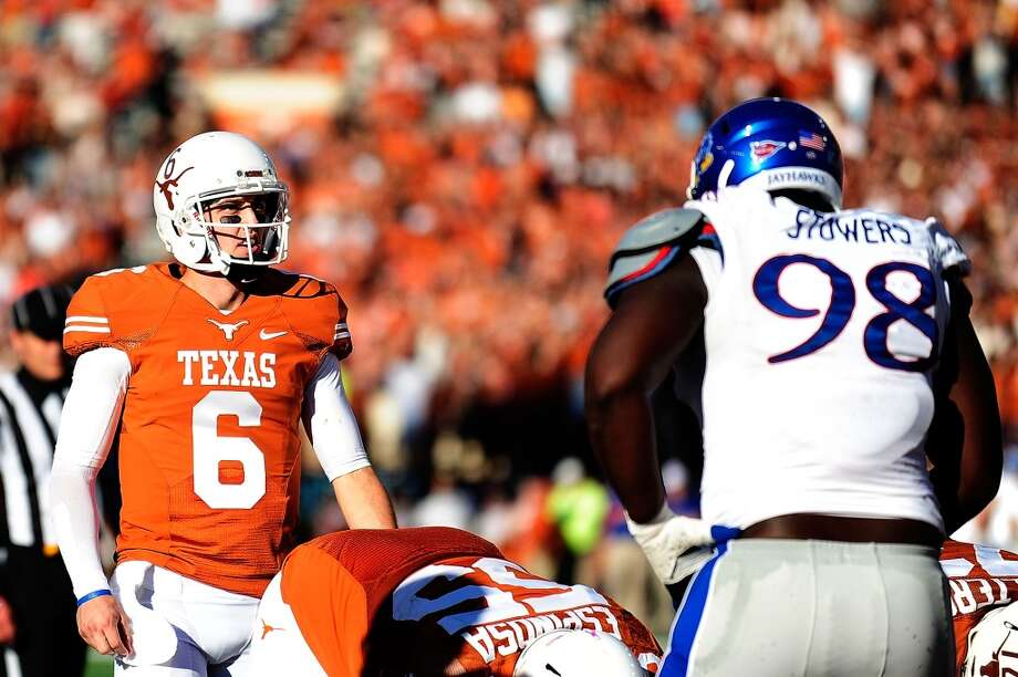 Keon Stowers #98 of the Jayhawks lines up against Case McCoy #6 of the Longhorns. Photo: Stacy Revere, Getty Images