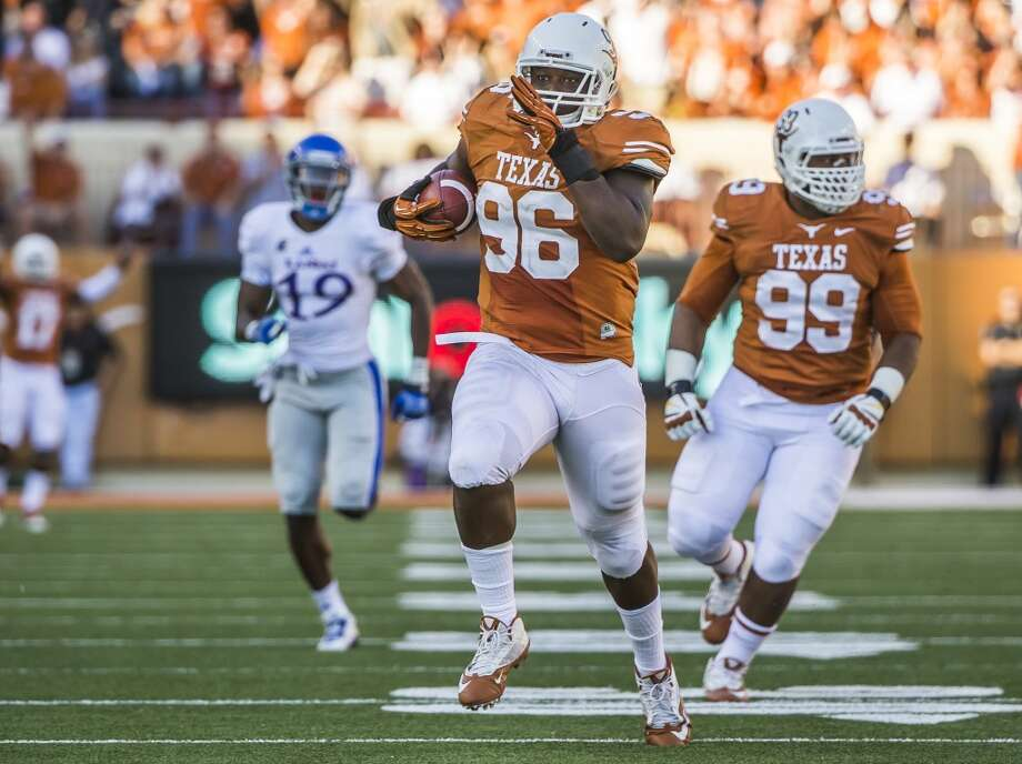 Texas' Chris Whaley (96) recovers a fumble for a 40-yard touchdown. Photo: Ricardo Brazziell, McClatchy-Tribune News Service