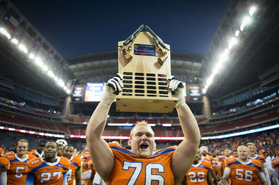 Sam Houston State 56, Steven F. Austin 49  Sam Houston State offensive linesman Matt Boyles celebrates after the Bearkats defeated Stephen F. Austin to claim the annual Battle of the Piney Woods at Reliant Stadium. Photo: Smiley N. Pool, Houston Chronicle