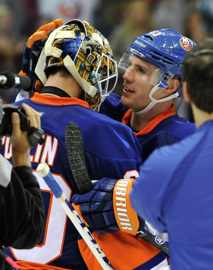 New York Islanders' Casey Cizikas (53) congratulates goalie Kevin Poulin after the Islanders beat the Boston Bruins 3-1 in an NHL hockey game at the Nassau Coliseum on Saturday, Nov. 2, 2013, in Uniondale, N.Y. (AP Photo/Kathy Kmonicek) ORG XMIT: NYI109 Photo: Kathy Kmonicek / FR170189 AP