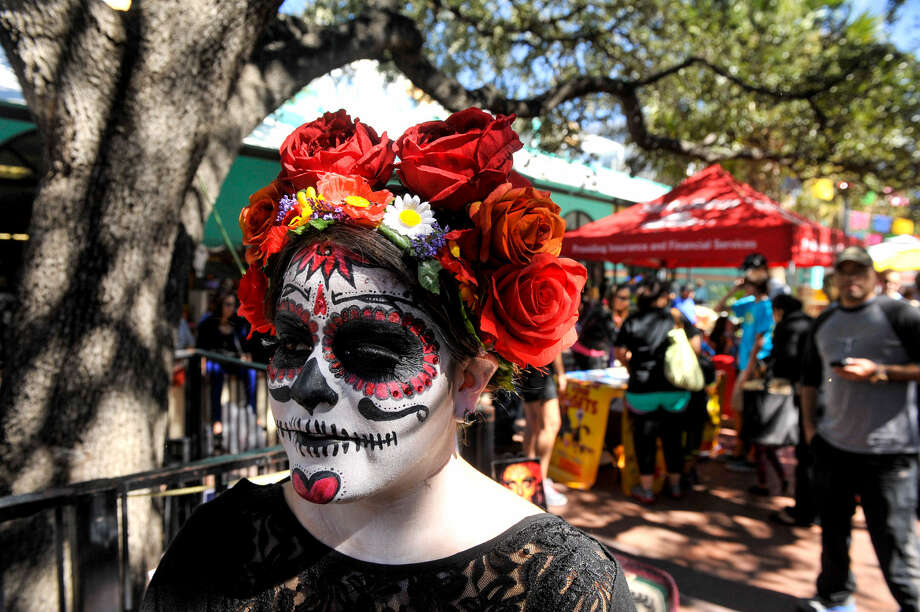 Francheska Rios sports elaborate face paint while strolling through Market Square during                    Día de los Muertos festivities. Photo: Robin Jerstad / For The San Antonio Express-News