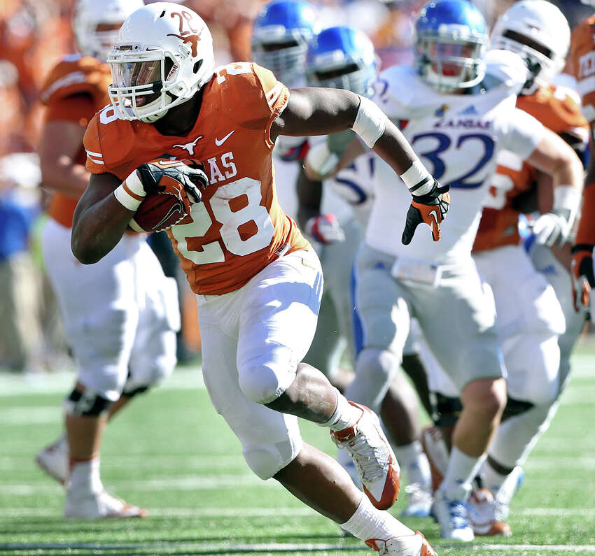 Malcom Brown breaks to the open field in the first half as Texas hosts Kansas at Darrell K. Royal Stadium on November 2, 2013.
