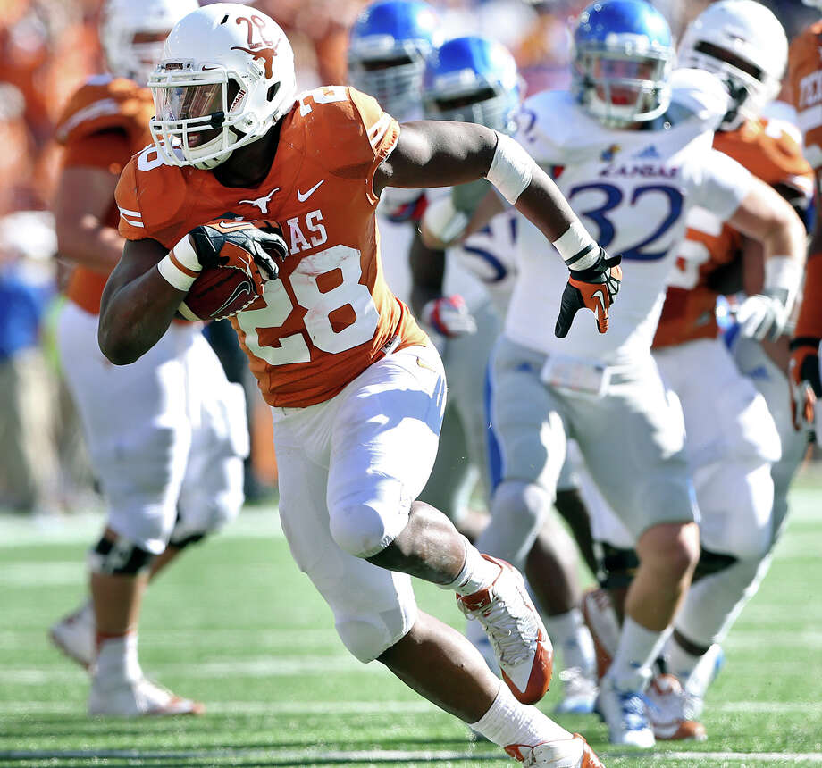 Malcom Brown breaks to the open field in the first half as Texas hosts Kansas at Darrell K. Royal Stadium  on November 2, 2013. Photo: TOM REEL, San Antonio Express-News
