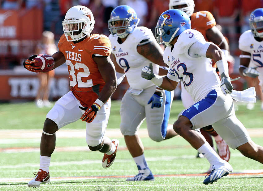Johnathan Gray breaks to the open field in the first half as Texas hosts Kansas at Darrell K. Royal Stadium on November 2, 2013.
