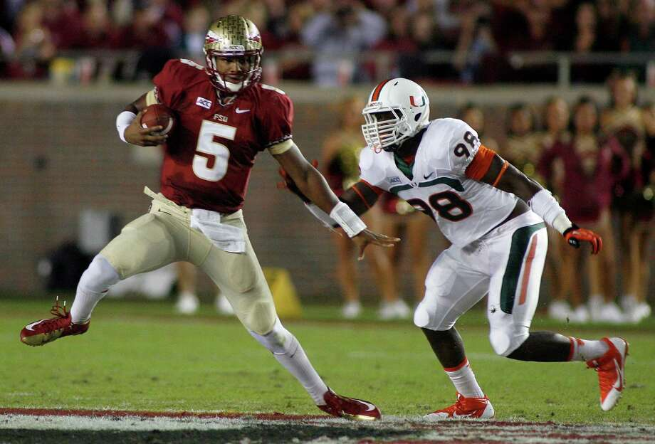 Florida State quarterback Jameis Winston sidesteps Miami defensive end Al-Quadin Muhammad. Photo: Phil Sears, FRE / FR170567 AP