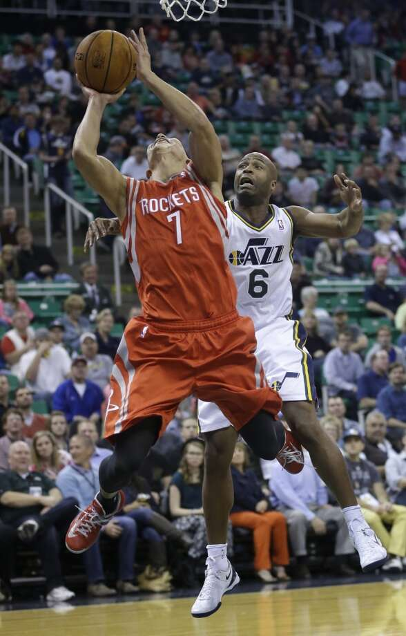 Nov. 2: Rockets 104, Jazz 93   Jeremy Lin (7) goes to the basket as Jamaal Tinsley (6) defends. Photo: Rick Bowmer, Associated Press