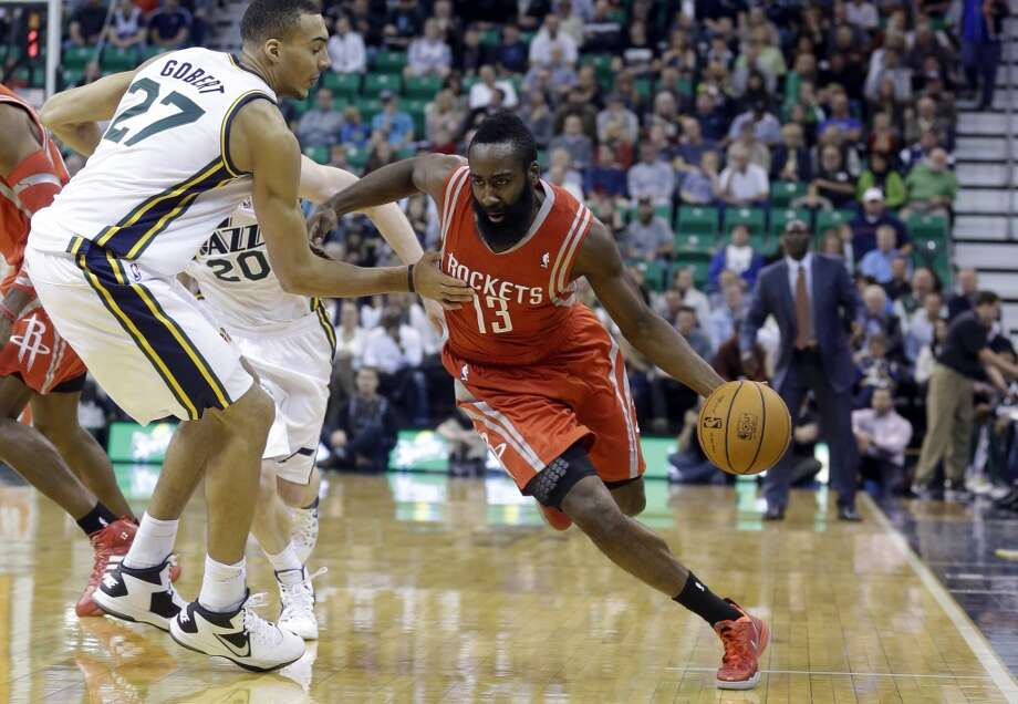 James Harden (13) drives around Rudy Gobert (27), of France. Photo: Rick Bowmer, Associated Press