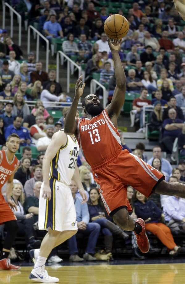 James Harden (13) shoots as Gordon Hayward (20) looks on. Photo: Rick Bowmer, Associated Press