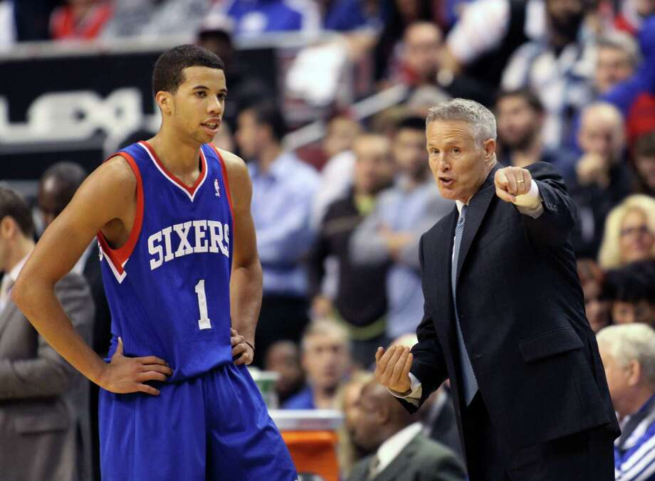 Philadelphia 76ers coach Brett Brown speaks to Michael Carter-Williams (1) as they play the Chicago Bulls in the second  half of an NBA basketball game Saturday Nov. 2, 2013, in Philadelphia. The 76ers won 107-104. (AP Photo/H. Rumph Jr) ORG XMIT: PXC111 Photo: H. Rumph Jr / FR61717 AP