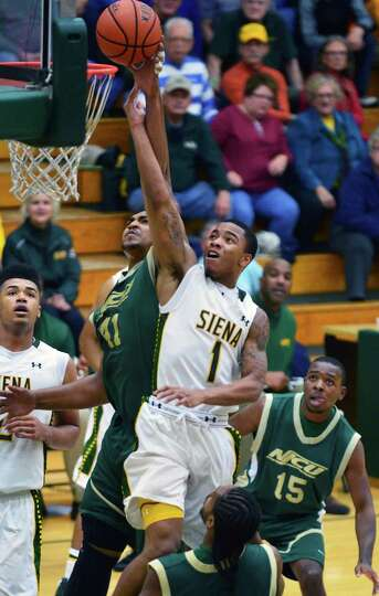 Siena's #1 Marquis Wright blasts through New Jersey City University's defense on his way to the bask