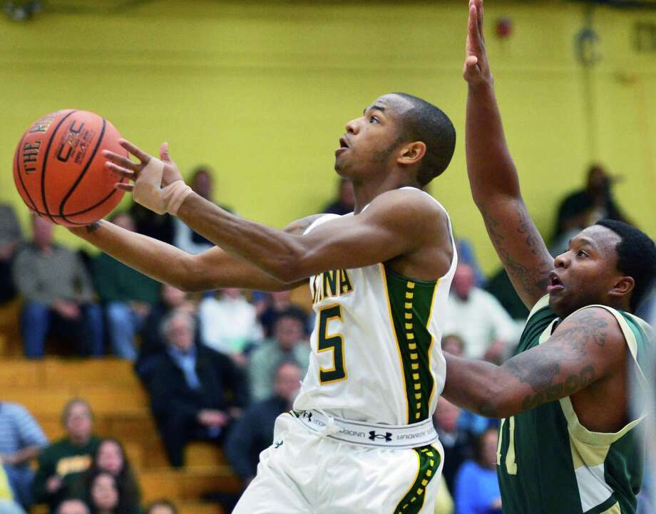 Siena's #5 Evan Hymes, left, gets past New Jersey City University's 11 Khalid Muhammad to go to the basket during an exhibition game at Siena's Alumni Recreation Center Saturday Nov. 2, 2013,in Colonie, NY.   (John Carl D'Annibale / Times Union) Photo: John Carl D'Annibale / 00024475A
