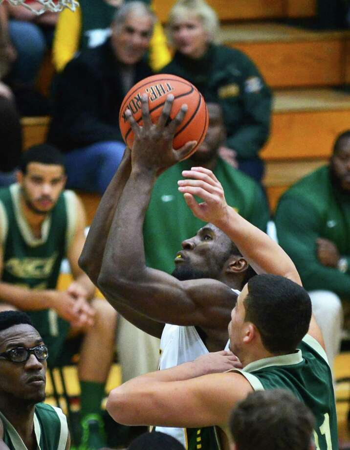 Siena's #34 Imoh Silas, center, gets a shot through New Jersey City University's defense during an exhibition game at Siena's Alumni Recreation Center Saturday Nov. 2, 2013,in Colonie, NY.   (John Carl D'Annibale / Times Union) Photo: John Carl D'Annibale / 00024475A