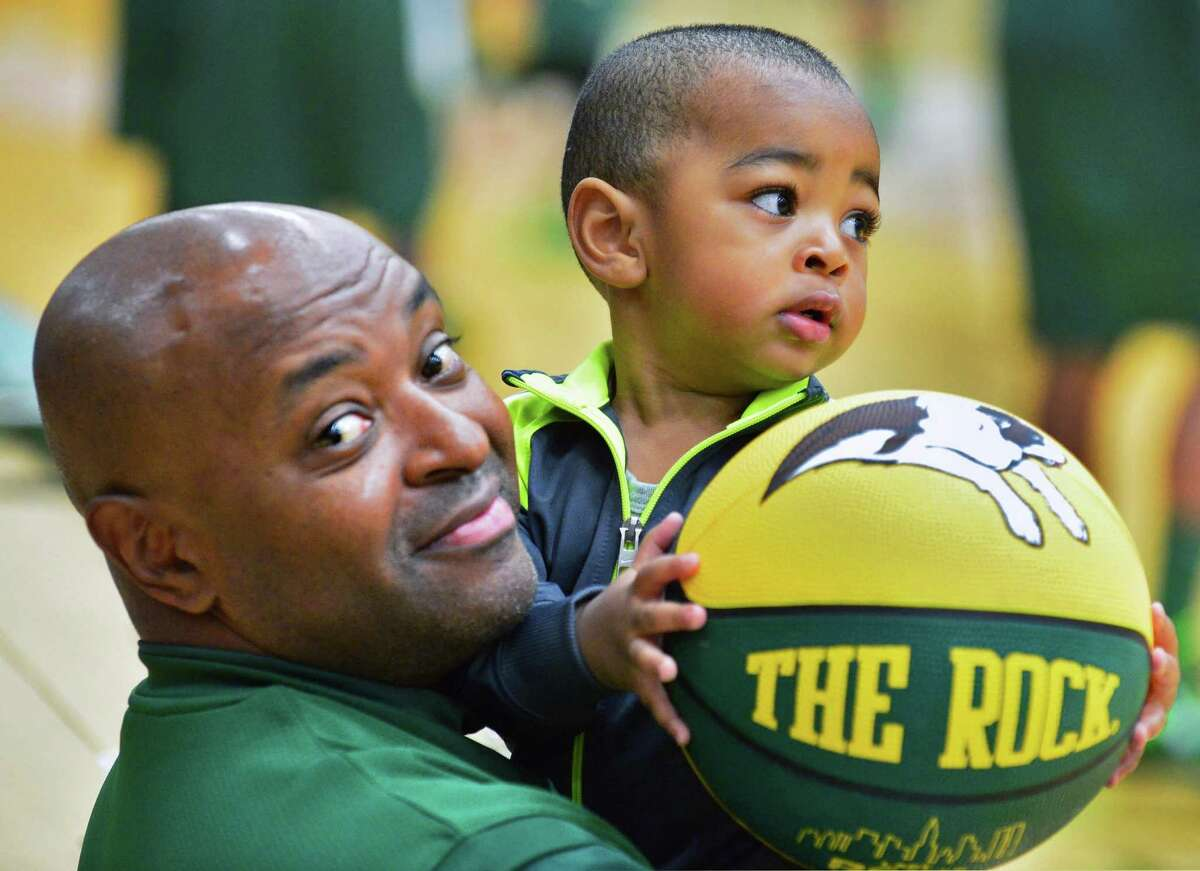 Former Siena star, now head coach for New Jersey City University, Marc Brown with youngest son, 19-month -old Mason Brown, before the start of an exhibition game against his former team at Siena's Alumni Recreation Center Saturday Nov. 2, 2013,in Colonie, NY. (John Carl D'Annibale / Times Union)