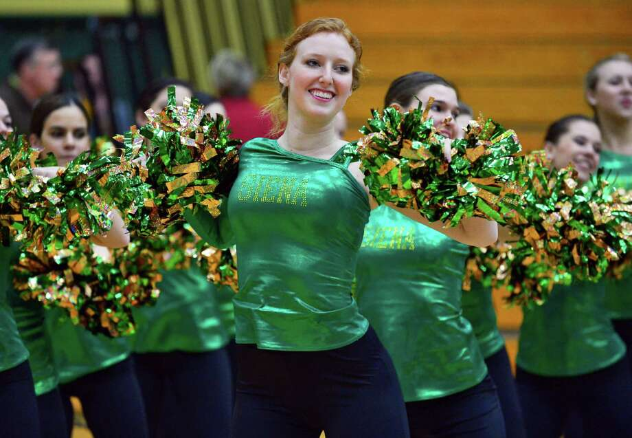 Ryan Elizebeth O'Neil, center, performs with Siena's dance team during an exhibition game at Siena's Alumni Recreation Center against New Jersey City University Saturday Nov. 2, 2013,in Colonie, NY.   (John Carl D'Annibale / Times Union) Photo: John Carl D'Annibale / 00024475A