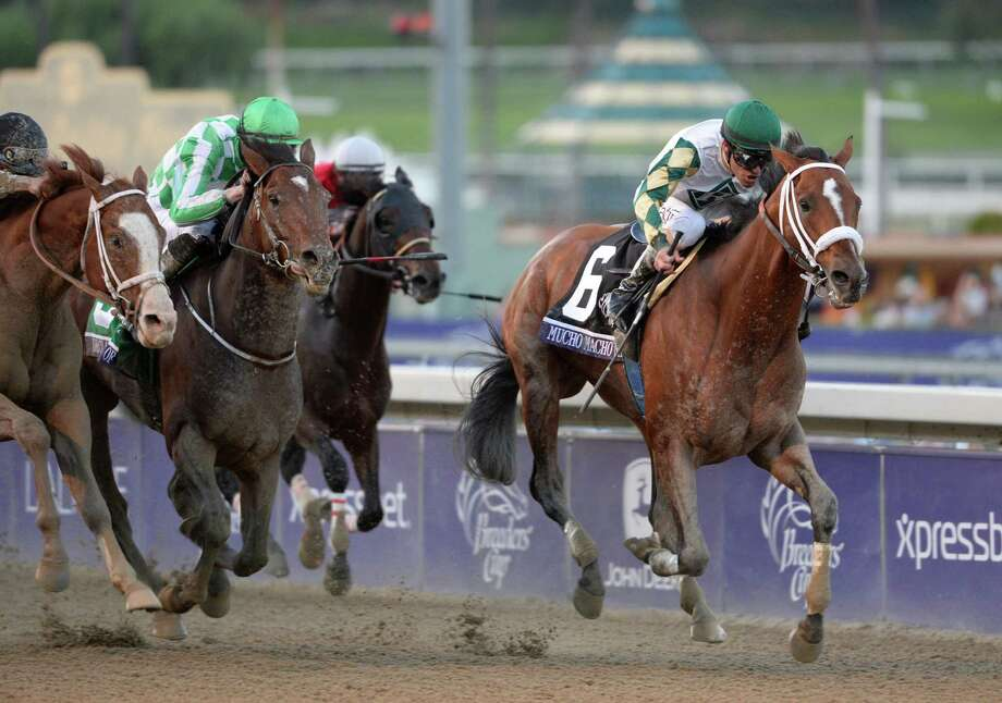 Gary Stevens aboard Mucho Macho Man, holds off a late charge from Will Take Charge and Luis Saez, left and Declaration of War ridden by Joseph O'Brien to win the 30th running of The Breeders' Cup Classic  Nov. 2, 2013 at Santa Anita Park in Arcadia, California.   (Skip Dickstein/Times Union Photo: SKIP DICKSTEIN