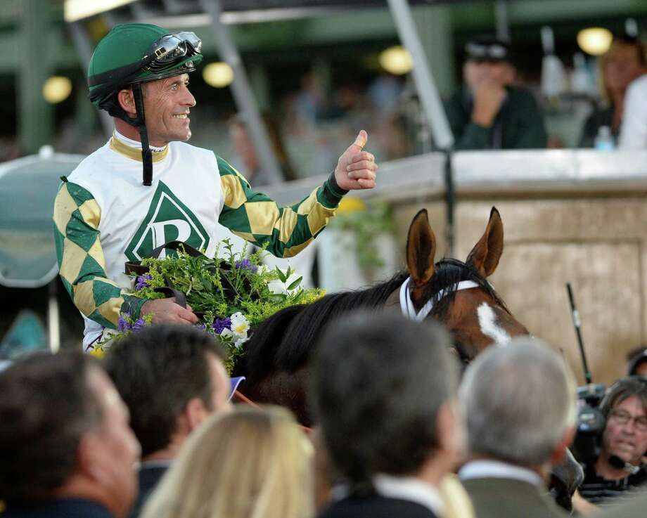 Gary Stevens gives a thumbs up after winning the 30th running of The Breeders' Cup Classic  Nov. 2, 2013 at Santa Anita Park in Arcadia, California.   (Skip Dickstein/Times Union Photo: SKIP DICKSTEIN