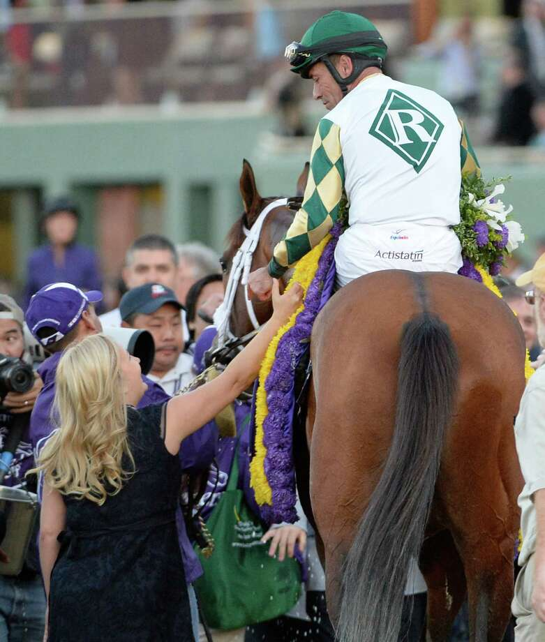 Gary Stevens is greeted by trainer Kathy Ritvo aboard Mucho Macho Man after winning the 30th running of The Breeders' Cup Classic  Nov. 2, 2013 at Santa Anita Park in Arcadia, California.   (Skip Dickstein/Times Union Photo: SKIP DICKSTEIN