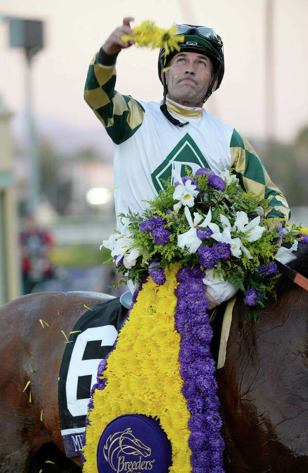 Gary Stevens throws the flowers from the winner's blanket aboard Mucho Macho Man after winning the 30th running of The Breeders' Cup Classic  Nov. 2, 2013 at Santa Anita Park in Arcadia, California.   (Skip Dickstein/Times Union Photo: SKIP DICKSTEIN