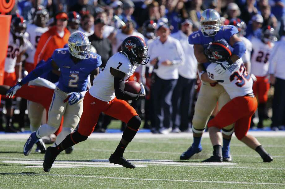 UTSA's Triston Wade intercepts his first pass Saturday. He later would return one 82 yards for a score. Photo: Tom Gilbert / Tulsa World