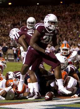 Texas A&M Aggies running back Tra Carson celebrates a touchdown during the second quarter of an NCAA college football game against the UTEP Miners at Kyle Field Saturday, Nov. 2, 2013, in College Station. (Cody Duty / Houston Chronicle) Photo: Cody Duty, Houston Chronicle