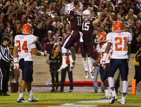 Texas A&M Aggies wide receiver Derel Walker, left, and wide receiver Travis Labhart, right, celebrate after Labhart caught a touchdown pass as a host of UTEP Miners defenders look on during the the third quarter of an NCAA college football game at Kyle Field Saturday, Nov. 2, 2013, in College Station. (Cody Duty / Houston Chronicle) Photo: Cody Duty, Houston Chronicle