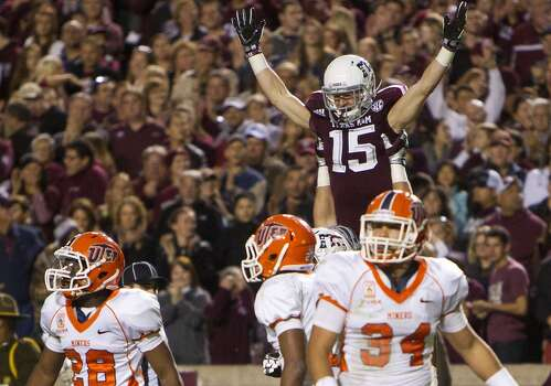 Texas A&M Aggies offensive linesman Mike Matthews lifts wide receiver Travis Labhart in the air as they celebrate after Labhart caught a touchdown pass as a host of UTEP Miners defenders look on during the third quarter of an NCAA college football game at Kyle Field Saturday, Nov. 2, 2013, in College Station. (Cody Duty / Houston Chronicle) Photo: Cody Duty, Houston Chronicle