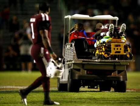 Texas A&M Aggies running back Ben Malena, left, watches as teammate and running back Tra Carson is carted off the field during the fourth quarter of an NCAA college football game against the UTEP Miners at Kyle Field Saturday, Nov. 2, 2013, in College Station. (Cody Duty / Houston Chronicle) Photo: Cody Duty, Houston Chronicle