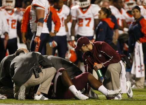 Texas A&M Aggies render aid to running back Tra Carson after he was injured during the second half of an NCAA college football game against the UTEP Miners at Kyle Field Saturday, Nov. 2, 2013, in College Station. (Cody Duty / Houston Chronicle) Photo: Cody Duty, Houston Chronicle