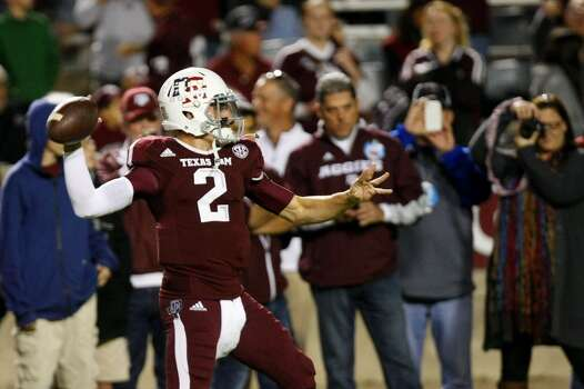 Texas A&M Aggies quarterback Johnny Manziel warms up before an NCAA college football game against the UTEP Miners at Kyle Field Saturday, Nov. 2, 2013, in College Station. (Cody Duty / Houston Chronicle) Photo: Cody Duty, Houston Chronicle