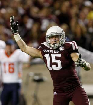 Texas A&M Aggies wide receiver Travis Labhart looks to the officials for a call after a UTEP Miners defender pressured him during the second quarter of an NCAA college football game at Kyle Field Saturday, Nov. 2, 2013, in College Station. (Cody Duty / Houston Chronicle) Photo: Cody Duty, Houston Chronicle