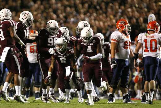 Texas A&M Aggies defensive back Noel Ellis, center, celebrates after he recovered a fumble from UTEP Miners wide receiver Jordan Leslie during the second quarter of an NCAA college football game at Kyle Field Saturday, Nov. 2, 2013, in College Station. (Cody Duty / Houston Chronicle) Photo: Cody Duty, Houston Chronicle