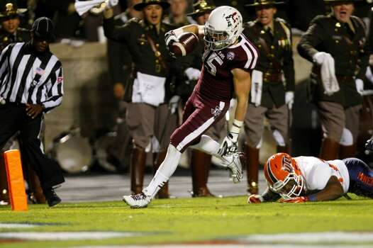 Texas A&M Aggies wide receiver Travis Labhart runs in a touchdown after shaking a tackle from a UTEP Miner during the first quarter of an NCAA college football game at Kyle Field Saturday, Nov. 2, 2013, in College Station. (Cody Duty / Houston Chronicle) Photo: Cody Duty, Houston Chronicle