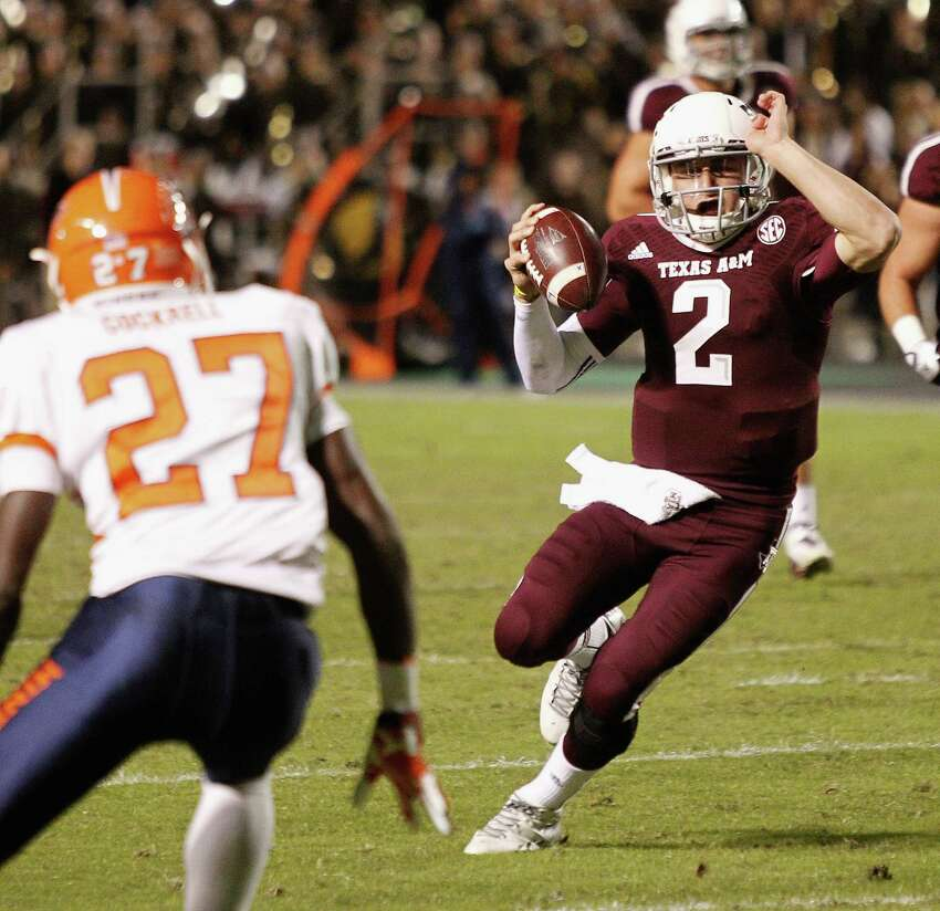 COLLEGE STATION, TX - NOVEMBER 02: Johnny Manziel #2 of the Texas A&M Aggies runs with the ball in the second quarter as defensive back Devin Cockrell #27 of the UTEP Miners looks to make a tackle at Kyle Field on November 2, 2013 in College Station, Texas.