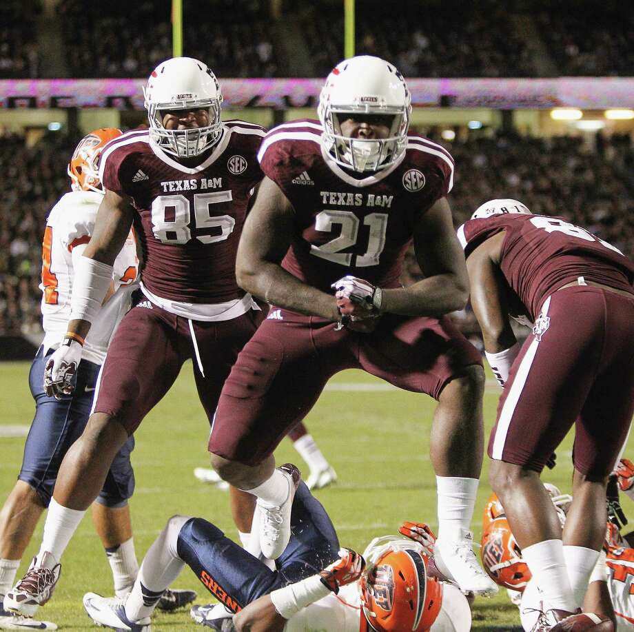 COLLEGE STATION, TX - NOVEMBER 02:  Tra Carson #21 of the Texas A&M Aggies celebrates after scoreing in the first quarter against the UTEP Miners at Kyle Field on November 2, 2013 in College Station, Texas. Photo: Bob Levey, Getty Images / 2013 Getty Images