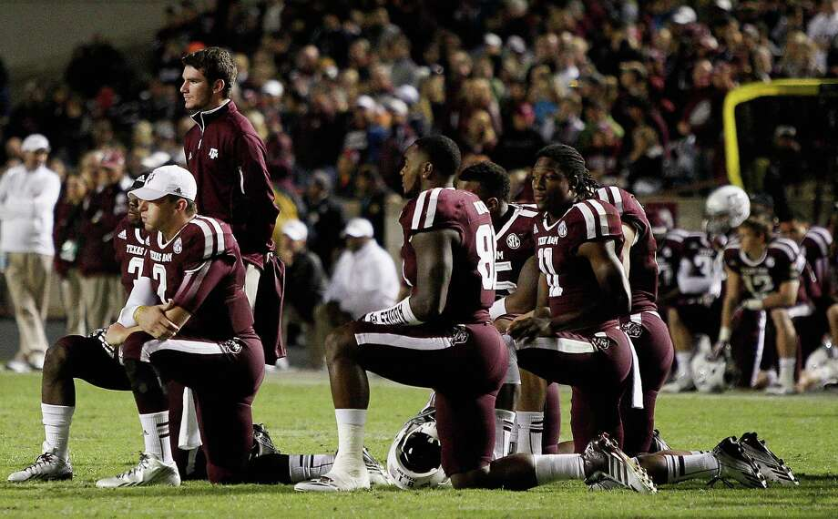 COLLEGE STATION, TX - NOVEMBER 02: Johnny Manziel #2 of the Texas A&M Aggies and his teammates look on as Tra Carson #21 of the Texas A&M Aggies lays injured on the field in the fourth quarter at Kyle Field on November 2, 2013 in College Station, Texas. Photo: Bob Levey, Getty Images / 2013 Getty Images