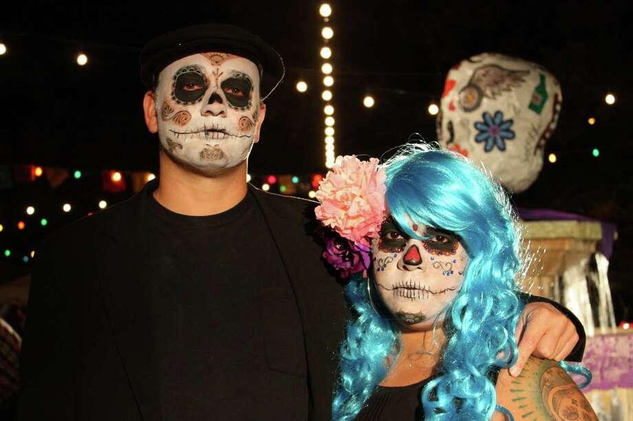 Revelers attend the Día de los Muertos celebration at La Villita on Saturday, Nov. 2, 2013. Photo: Libby Castillo / For MySA.com