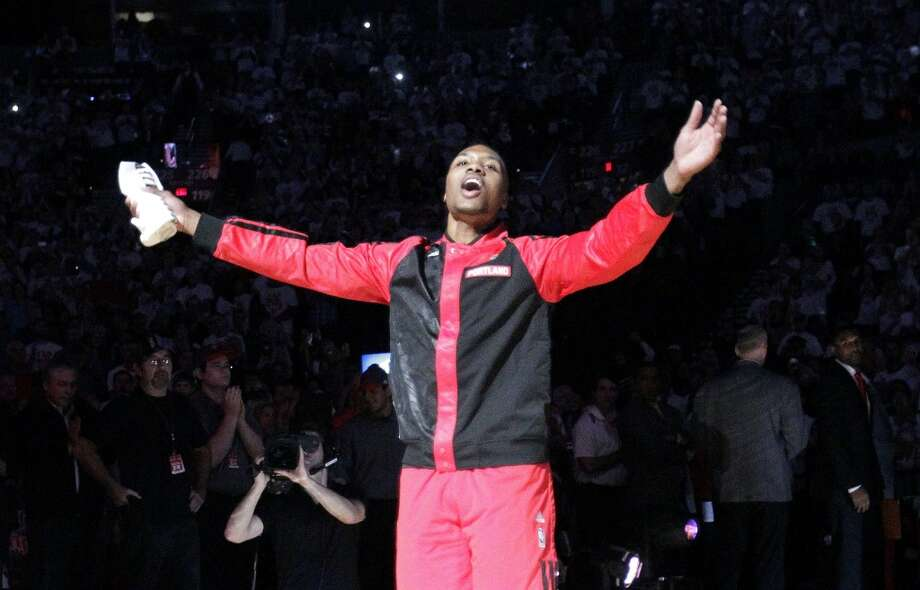 Portland Trail Blazers guard Damian Lillard is introduced for the NBA basketball team's home-opener against the San Antonio Spurs in Portland, Ore., Saturday, Nov. 2, 2013. Photo: Don Ryan, Associated Press